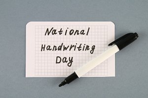 A note with an inscription is a national day of hand writing and a marker.