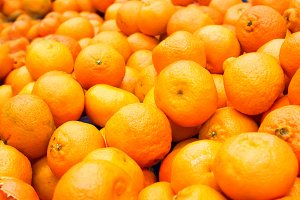 Pile of fresh orange mandarins