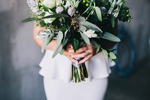 Bride with green wedding bouquet