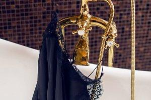black silk top hanging on golden mixer