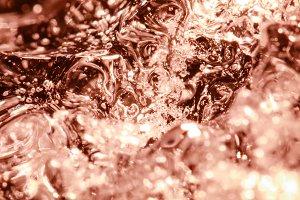 Frozen water bubbles in brown ice