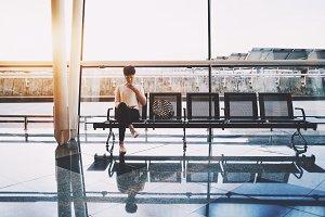 Girl waiting in airport terminal