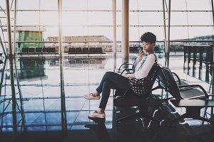 Brazilian girl waiting in airport