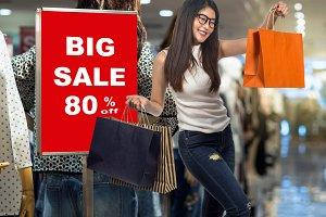 Happy young asian woman shopping