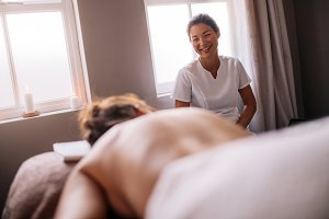 Masseur talking with female