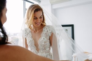 Attractive future bride fitting new