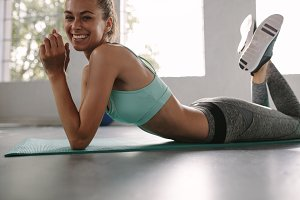 Smiling female resting after fitness