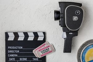 Clapperboard and old movie camera
