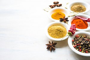 Different spices on rustic table