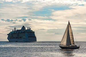 Blue sailboat in travel