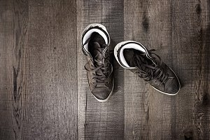 Sneakers on floor on wooden
