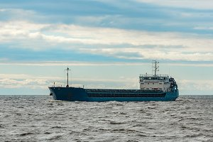 Blue cargo ship underway
