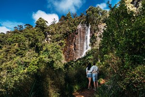 Couple admires a beautiful waterfall
