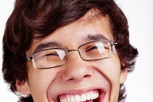 Smiling guy in glasses closeup