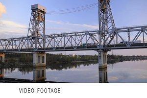 Sailing under bridge on river Volga