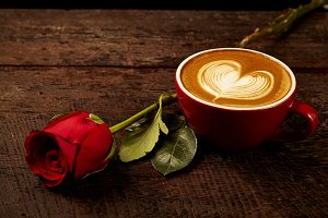 cappuccino with red rose on wood tab