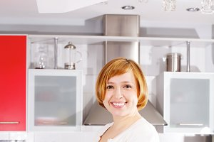Young woman standing at kitchen