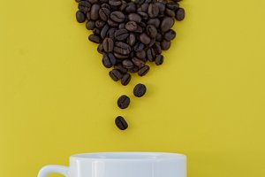 Coffee beans in shape of heart  with