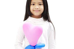 Cute little asian girl holding pink