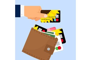 Hand taking credit card from wallet