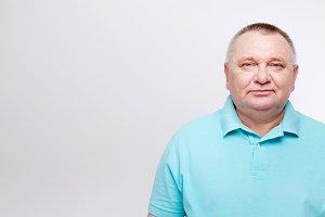 Mature man in blue shirt