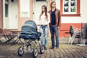 Young Parents With Baby Stroller In The City