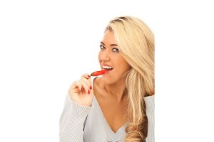 Young Woman Having A Red Hot Chilli Pepper