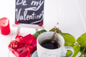 Red rose, coffee cup and gift box