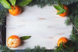 Fresh tangerines on white board