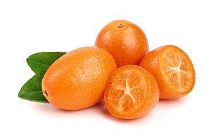 Cumquat or kumquat with leaf isolated on white background close up