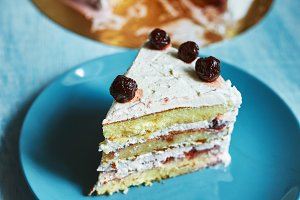layered biscuit with curd cream and cherry