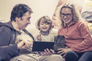 Happy family and digital tablet