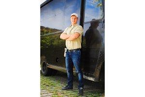 Delivery Boy Standing Next To His Van