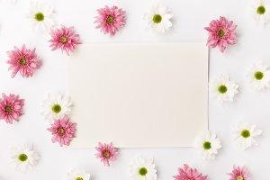 Blank paper in flowers