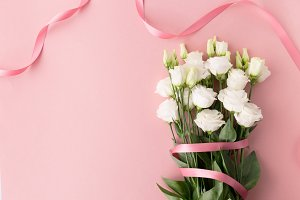 white roses with pink ribbon