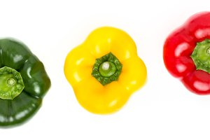 Three peppers of different colors