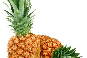 Two ripe pineapple isolated on white background
