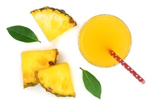 pineapple juice in a glass with pineapple slices isolated on white background. Top view