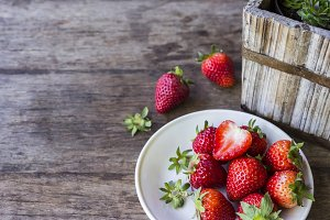 Fresh strawberry on the wood table