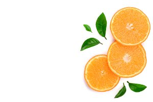 orange or tangerine slices with leaves isolated on white background. Flat lay, top view. Fruit composition