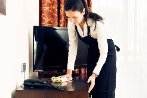 Maid Making Up A Hotel Room