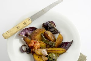 baked vegetable dish on white backgr
