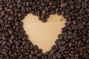 Heart symbol made of coffee beans