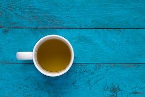 Green tea on blue wooden background