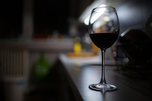 Glass of red wine night low light