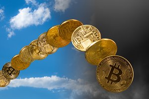 Bitcoin coins rising and falling from the sky