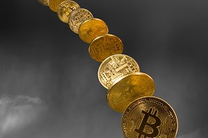 Bitcoin coins dropping from the sky