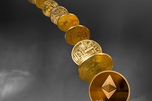 Ether and bitcoin coins dropping from the sky