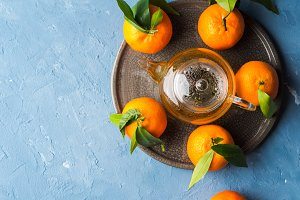Tangerines and green tea still life