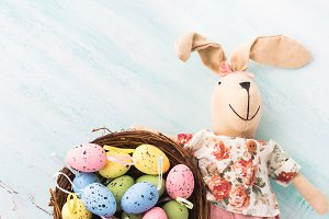 Easter bunny doll quail painted egg nest pastel backdrop